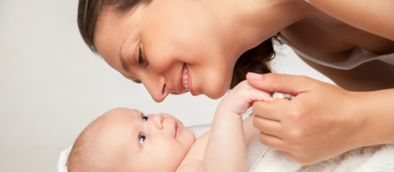 Happy baby and mother after egg freezing success