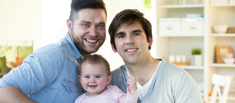 LGBT couple happy after surrogacy