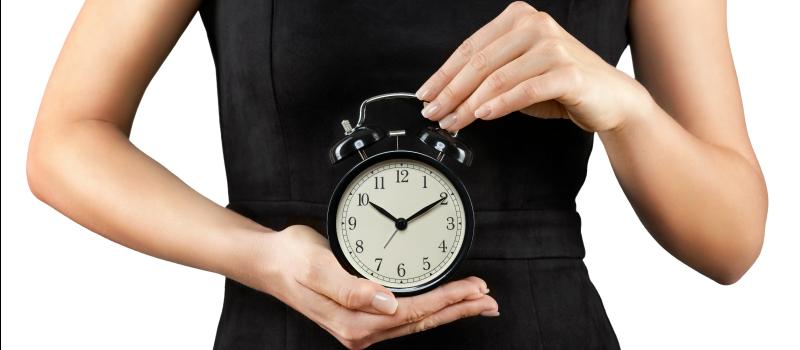 female holding the biological clock