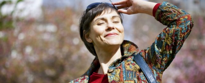 Happy Woman Taking Vitamin D for her Fertility